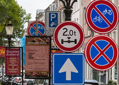 A Confusion of Signs (natures-pencil) Tags: hambergerbrug utrecht nederland netherlands sign signs nobikes 2tonlimit oneway parkingrestriction advertising restaurants lamppost streetlights citycentre lovelycity confusion street