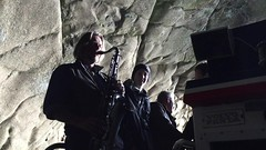 Playing saxophone to demonstrate acoustics in a cave (Photographer Rita Bærum) Tags: iceland klettshelli vestmannaeyjar heimaey viking tours
