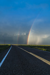 Highway of Rainbows (Tom Herlyck) Tags: rainbow road colorado sunset prairie weather rain highplains southeasterncolorado amazing beautiful clouds easterncolorado flickr greatamericandesert sky light southeastcolorado southerncolorado hwy10