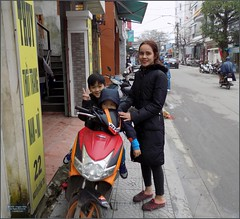 Vietnam, Hue Honda Family 20180213_093500 DSCN3167 (CanadaGood) Tags: asia asean seasia vietnam vietnamese hue building people person shopping honda motorcycle scooter parking advertising sign tree canadagood 2018 thisdecade color colour