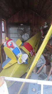 Flying Circus - Kids airplane ride in storage