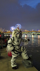 Furworks and Fireworks (Coyoty) Tags: anthrocon2018 pittsburgh pennsylvania pa furry convention anthropomorphics fandom anthrocon fursuit fun furries furryfandom cosplay mascot costume tiger sabertooth sabretooth monster striped fireworks holiday independenceday july4th patriotic night river bridge celebration lights people explosives clouds riverfront mooring davidllawrenceconventioncenter sky smile blue white gray grey lighting water scenic color