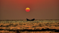 The lonely boat on a golden time (TJ Ony) Tags: popular goldenhour seabeach bangladesh sunset saintmartin orange suninred sunburned beautifulnature sealove