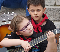 concentration (albyn.davis) Tags: people child children red color music guitar glasses girl boy performing performance