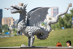 Metal sculpture of the winged snake Zilant (Jess Aerons) Tags: mythology tatarstan crown day dragon emblem heraldry kazan metal blue republic russia sculpture sky symbol tail tongue wyvern zilant monument serpent mythical spring city official tatar basilisk clouds white winged wings architecture scales arms blazonry cloud coat famous fantasy historical history landmark outdoor scale squama statue summer sunlight sunny traditional