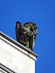 Pensive Pegasus (Reva G) Tags: gargoyle carving stone statuary statue hotelvancouver vancouver bc architecture pegasus horse wings moss building hotel corner blue sky burrard