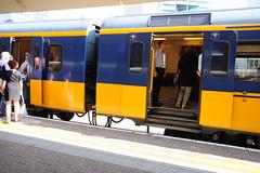 DSCF7755 (amsfrank) Tags: amsterdam candid public transport translation zuid zuidas ns nederlandse spoorwegen dutch railways conducteur guard proud