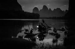 cormorant fisherman midnight blue-1-3 (jkardysphotos) Tags: china2018 cormorantfisherman sunset guilin china lantern mountains karst liriver