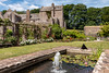 Compton Castle and rose garden with pond (Keith in Exeter) Tags: castle comptoncastle devon nationaltrust garden pond pergola flower rose water lily fountain grass lawn paving building architecture tree sky landscape