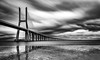 The great path (Artur Tomaz Photography) Tags: clouds le lisboa lisbon ponte pontevascodagama vascodagama blackandwhite blue bridge depth longexposition mono monochrome nature reflexions river tejo water