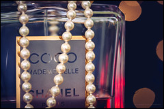 Coco Mademoiselle (G. Postlethwaite esq.) Tags: canon40d canonefs60mmmacro chanel coco dof macro mademoiselle bokeh bottle depthoffield jewelry label pearls perfume photoborder primelens selectivefocus closeup