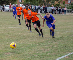 Lutterworth Town (nonleaguepap) Tags: lutterworth town heanor derbyshire leicestershire fa cup extra preliminary round black orange shirts shorts boots players non league football united counties total midland white lines green grass purple trees saturday sports august 2018