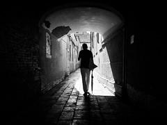 man with umbrella (Sandy...J) Tags: olympus fotografie photography passage durchgang darkness light sunlight monochrom man mood street streetphotography sw schwarzweis strasenfotografie stadt silhouette shadow strase gegenlicht blackwhite bw backlight walking urban noir