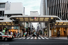 Shijo Street (heyyyitsleslie) Tags: japan kyoto travel 2018 street car people shopping light sky buildings canon adobe adobelightroomclassiccc canonrebelt3i mall taxi road architecture building everyday