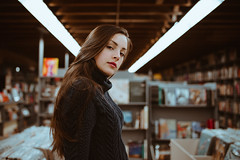 Browsin' (MarvinHrrr) Tags: portrait woman girl brunette beautiful young long hair red lips turtle neck canada vancouver pentax sigma book store record