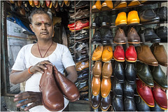 Mumbai Cobbler (channel packet) Tags: india mumbai street stall shoe maker cobbler footwear commerce davidhill