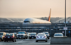 asiana airlines holds for gate assignment (pbo31) Tags: bayarea california nikon d810 color august 2018 summer boury pbo31 urban city roadway sfo sanfranciscointernational airport aviation plane travel sanbruno sanmateocounty flight airline asianaairlines holding airbus orange sunset parking lot sound wall cargo