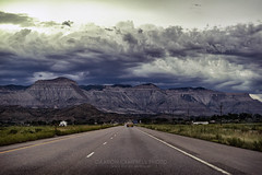 Ominous Skies, 2015.07.14 (Aaron Glenn Campbell) Tags: mesacounty colorado i70 interstate highway eastbound erosion outdoors roadtrip vacation family relatives rental car vehicle toyotacamry summer sky clouds ominous gloomy landscape sony a6000 ilce6000 mirrorless zeiss fe2470mmf4zaoss telephoto zoom nikcollection analogefexpro colorefexpro viveza