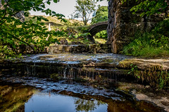 Underneath the arches (Peter Leigh50) Tags: stream beck brook water wet drip reflection bridge viaduct landscape wood trees railway rural countryside leaves grass fujifilm fuji xt2