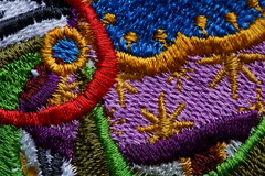 Christmas Embroidery (steve_whitmarsh) Tags: macro closeup colour purple blue yellow red green gold thread embroidery art craft macromondays multicolour