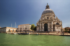 Basilica di Santa Maria della Salute - Venezia (Italy) (Andrea Moscato) Tags: andreamoscato italia veneto view vivid vista shadow ombre light luce sky sea seascape mare laguna acqua water gondola island isola architecture architettura history historic ancient blue white boat waves afternoon reflection riflesso church chiesa pier pontile cielo city città cityscape boardwalk canal canale panorama people tourist cupola green square marble door dogana grande baroque