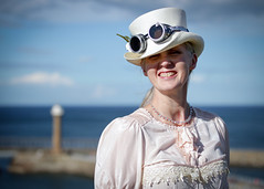Portrait of Evelyn at the Whitby Steampunk Weekend IV - Days Like These (Gordon.A) Tags: yorkshire whitby steampunk whitbysteampunkweekend iv dayslikethese wsw july 2018 convivial creative costume hat goggles culture lifestyle style fashion lady woman people street festival event streetevent eventphotography day daylight sky outdoor outdoors outside pier amateur streetphotography pose posed portrait streetportrait colourportrait colourstreetportrait naturallight naturallightportrait digital canon eos 750d sigma sigma50100mmf18dc