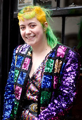Rae - stranger 158/200 (englishreader) Tags: 100strangers strangers stranger strangerphotography street streetphotography streetportrait portraitphotography portrait portraiture people peoplephotography female girl girls woman lady younglady youngwoman thehumanfamily colour color colours colors colourful colorful brightcolors brightcolours pattern sequins sparkle shine colouredhair coloredhair yellowhair greenhair sun buckle beltbuckle window building bricks windowframe purple magenta blue green red gold yellow black happy smile smiling availablelight naturallight daylight 50mmlens primelens canon