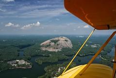 Stone Mountain Park | Biplane Ride | August 16, 2018 (steveartist) Tags: stonemountain georgia aerialphoto biplaneride clouds wings lumixlx100 snapseed stevefrenkel lakes trees forest housing