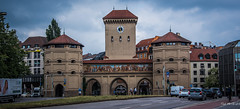2018 - Germany - Munich - Isar Gate (Ted's photos - Returns Late November) Tags: 2018 cropped germany munich münchen nikon nikond750 nikonfx tedmcgrath tedsphotos vignetting isargate munichisargate isargatemunich isartor munchenisartor isartormünchen isartormunich munichisartor tower gate munichgermany hoteltorbrau streetscene street people peopleandpaths pathsandpeople vehicles mural bernhardvonneher friedrichvongärtner arches clock clockface