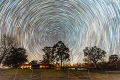 Star Trail on Rural Property with gum trees and house (Merrillie) Tags: earth night nightsky glitter landscape winter rotation astrophotography australia movement longexposure lights rural astrology newsouthwales astro paddock nsw trees country astronomy outside gumtrees motion house milkyway sky tree rotating stars outdoors gresford