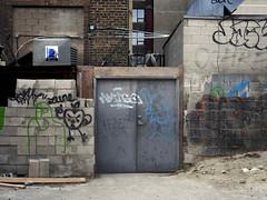 (geowelch) Tags: toronto urbanfragments newtopographics kensingtonmarket metal steel door olympusomdem5 panasoniclumixvario1445mm