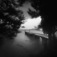 Old pier III (ilias varelas) Tags: pier light landscape land longexposure mood mono monochrome nature bw blackandwhite varelas atmosphere sky sea seascape square seafront greece trees windy