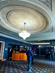 The Ravenscar Foyer (Steve Taylor (Photography)) Tags: ravenscarfoyer architecture digitalart carpet light blue grey brown people man newzealand nz southisland canterbury christchurch city isaactheatreroyal chandalier chandelier theater theatre