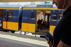 DSCF7763 (amsfrank) Tags: amsterdam candid public transport translation zuid zuidas ns nederlandse spoorwegen dutch railways conducteur guard proud