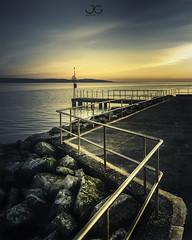 Marine Lake (jaygilmour11) Tags: fence water rocks sky sunset blue orange yellow black path lake jetty serene calm wales wirral westkirby merseyside metal nikon leefilters