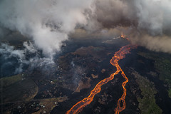 Luminous River (Kurt Lawson) Tags: 8 basalt bigisland channelized clouds cone dawn eight eruption fissure flow flowing glow hawaii helicopter houses kilauea lava leilaniestates lowereastriftzone molten morning pele pgv rain river source trees volcano