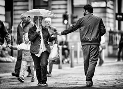 the connect (D Cation) Tags: scotland glasgow muslim freequran people interaction street umbrella