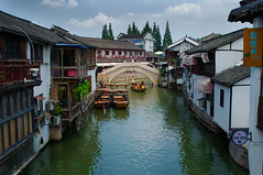Zhujiajiao (朱家角), China (Bokeh & Travel) Tags: zhujiajiao 朱家角 shanghai china 上海 bridge canal river water village town traditional colorful beautiful architecture 中华人民共和国 boats ancient asia