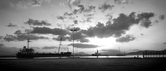 Early morning life (jimiliop) Tags: port morning sunrise blackandwhite kiato greece fishing ship man panorama sky clouds bicycle contrast birds