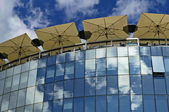 .....summer in the city..... (christikren) Tags: austria architecture building blue christikren city clouds facade glass lines linesandcurves panasonic perspective reflections sky travel tourist vienna view wien windows summer hanshollein architekt haashaus sonnenschirme parasol sommer hotel geometry umbrella contrast restaurant colours