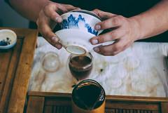 tea master at work (YellowTipTruck) Tags: teamasteratwork teaparty bunfight greentea tea crockery dishes pouredtea teatable