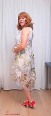 Floating skirt dress 3 (eileen_cd) Tags: flowerdress floatingskirt pearlclutchbag redheels nakedlegs standing crossdresser transvestite cd tv