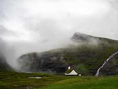Mists over Saksun (Feldore) Tags: faroeislands faroe islands saksun landscape mist misty fog foggy atmospheric green church waterfall remote mountains feldore mchugh em1 olympus 1240mm christianity ominous christian