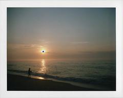 Fishing Under a Black Hole Sun (Joe_R) Tags: ocean film beach belmar newjersey unitedstates us silhouette peelapart packfilm polaroid sunrise