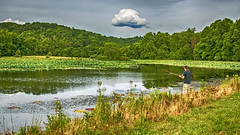 Fishing (jmhutnik) Tags: pond lotus mcclinticwildlifemanagementarea westvirginia fishing fisherman clouds hdr summer july