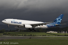 C-GPTS Airbus A330-200 Air Transat Glasgow airport EGPF 16.08-18 (rjonsen) Tags: plane airplane aircraft aviation airliner landing dark clouds