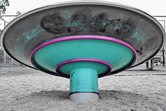 (Oliver Zimmermann) Tags: sonyalpha turquoisecolored builtstructure childrensplayground circle closeup colorkey day empty fence geometricshape lowangleview manmadeobject metal metalmaterial nopeople outdoors paint pinkcolor playground sand shape text