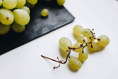 Close up of grapes on white background (wuestenigel) Tags: vineyard natural color sunset nature growing leaf beauty background healthy agriculture plant up macro growth wine cutting vine grape season closeup hands farming food harvest grapevine abstract summer symbol bunch beautiful close garden white grapes green nobody fruit hand organic