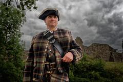 Urquhart Castle_Scottish security guard (abtabt) Tags: unitedkingdom uk lake scotland castle highlands ruins scottishhighlands scotch man d7001835g securityguard scottish blending hat tartan
