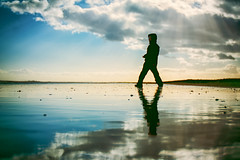 Say Something Cool (iratebadger) Tags: nikon nikond7100 d7100 beach beachlife sea reflections water child eldest silhouette shadows focus outside outoffocus blue mirror yorkshire yorkshirecoast clouds colours colors horizon walking